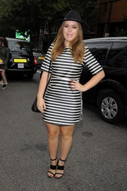 A pair of black strappy sandals continued the linear theme of Tanya Burr's dress.