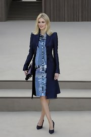 Donna Air kept her look both classic and modern with a fitted navy evening coat.