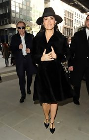 Salma Hayek is known for her classic and sophisticated style like this black walker hat, which she wore to London Fashion Week.