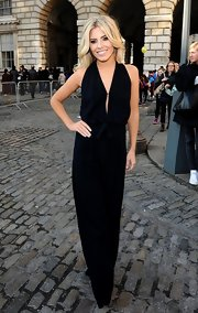 Mollie looked crazy hot in this slinky black jumpsuit for London Fashion Week.