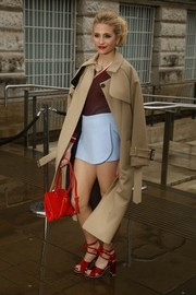 Pixie Lott teamed a pastel-blue skort with a maroon V-neck sweater, both by Topshop Unique, for the brand's fashion show.