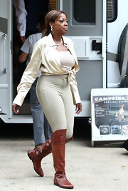 Starr Jones added pop to her beige outfit with a pair of ever so slightly over the knee cognac boots.