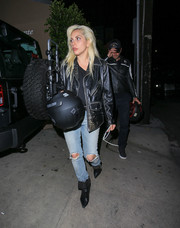 Lady Gaga kept the edgy vibe going with a pair of Saint Laurent studded boots.