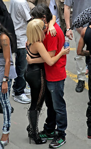 We caught a glimpse of Lady Gaga sharing a little affection with her boyfriend wearing lace up patent leather boots.