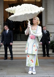 Lady Gaga completed her offbeat ensemble with a Luke Brooks 'Shellbrella.'