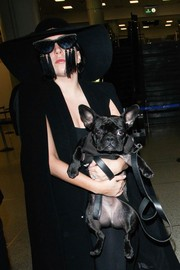 Lady Gaga topped off her airport look with a wide-brimmed hat by Eugenia Kim.