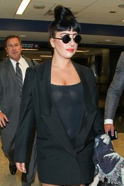 Lady Gaga strutted through LAX wearing a pair of round sunglasses.