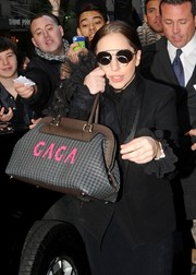 Lady Gaga topped off her look with funky round sunglasses.