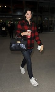 Lana Del Rey opted for a pair of classic skinny jeans for her travel look.