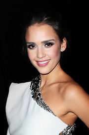 Jessica Alba attended the Lanvin fall 2012 runway show in Paris wearing intensely applied shadows in shades of metallic pewter and silver.