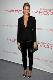 Stacy Keibler opted for a sleek menswear style at the launch of 'The Beauty Book,' daring to wear a black blazer without anything underneath.