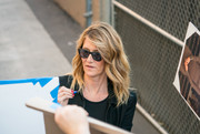 Laura Dern kept her eyes hidden behind a pair of wayfarers while signing autographs outside the 'Kimmel' studios.