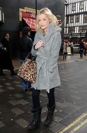 A pair of tough-looking black lace-up boots added a dose of edginess to Laura Whitmore's look.