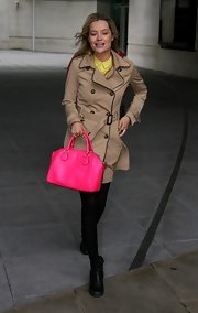 Laura Whitmore visited Radio 1 carrying an attention-grabbing neon-pink bowler bag.