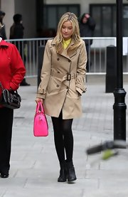 Laura Whitmore's black motorcycle boots were an edgy complement to her classic trenchcoat.