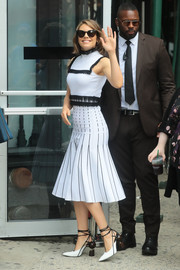 Lauren Cohan showed off her fabulous figure in a fitted white midi dress with black trim while out in New York City.