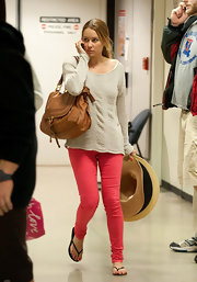 Lauren Conrad spiced up her slouchy top with a pair of on trend hot pink skinny jeans.