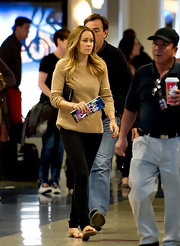 Lauren Conrad was minimalist chic at LAX in a camel crewneck sweater and a pair of black skinny jeans.