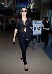 LeAnn Rimes traveled in style through LAX in a sheer black blouse paired with simple black pumps.