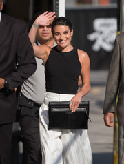 Lea Michele visited 'Jimmy Kimmel Live' carrying an oversized black clutch by Balenciaga.