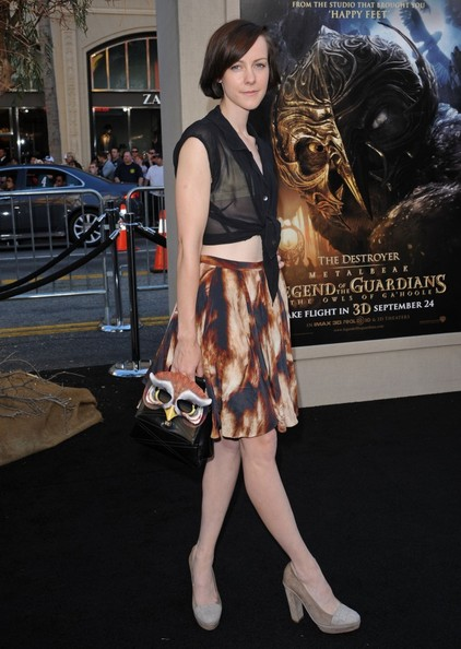 Jena paired her printed skirt and cropped top with an owl evening bag.