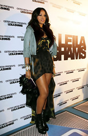 Eve toted a fancy black feathered clutch when she attended the 2012 Leila Shams Fashion Week party.