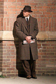 Leonardo DiCaprio looked mysterious in a brown wool coat over a suit in his film 'J. Edgar.'