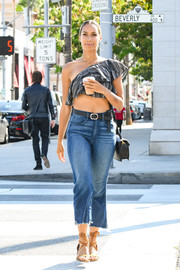 Leona Lewis turned heads on the streets of LA in a tiny one-shoulder crop-top.