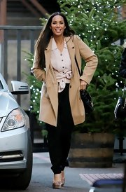 Leona Lewis was spotted leaving the London studios in a minimalist camel coat, tied blush blouse and black harem pants.