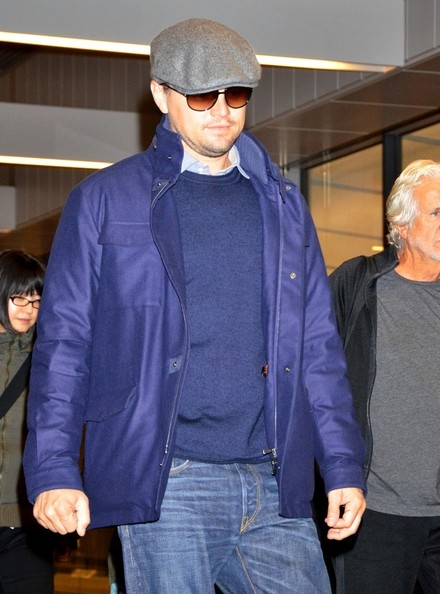 Leonardo DiCaprio kept his handsome face hidden with a gray ivy cap and a pair of shades during a trip to Tokyo.