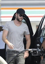 A striped tee topped off Liam Hemsworth's casual look while getting gas.