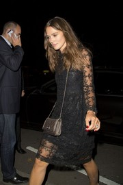 Keira Knightley paired a quilted gold Chanel bag with a sheer LBD for Liberty Ross' party.
