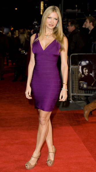 Caprice made a sexy entrance at the UK Premiere of 'Michael Jackson: The Life of an Icon' in this purple body-con bandage dress.