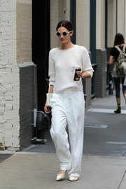 Lily Aldridge paired her sweater with baggy white pants by Chloe.