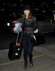 Lily Aldridge caught a flight at LAX looking sexy in a sheer lace top.