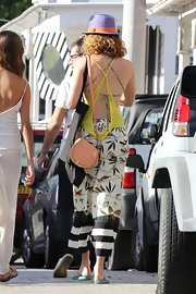 Lily Cole teamed a cute peach satchel with a breezy print dress for a shopping trip in St. Barts.
