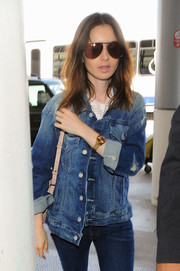 Lily Collins was classic and cool in her aviators while catching a flight out of LAX.