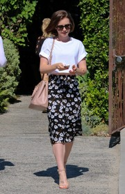 Lily Collins styled her top with a floral skirt, also by Ella Moss.