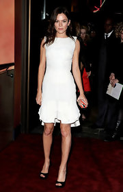 Anna Friel paired her ruffled white sheath dress with black platform peep toes.