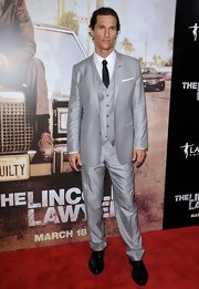 Matthew donned a slate gray three piece suit to the premiere of 'The Lincoln Lawyer.'