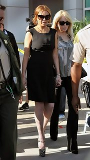 What does one wear to a court appearance? Sky-high platform pumps, of course!
