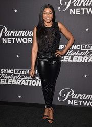 Taraji P. Henson went sporty-edgy on the bottom half with a pair of leather track pants.