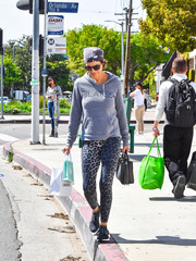 Lisa Rinna added some wild appeal with a pair of leopard-print leggings.