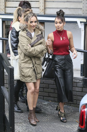 Jade Thirlwall teamed brown ankle boots with a fur-trimmed ultility jacket for a visit to the ITV Studios.