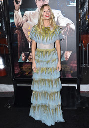 Sienna Miller looked very fancy at the LA premiere of 'Live by Night' in a tiered blue Gucci gown with chartreuse crystal embellishments.