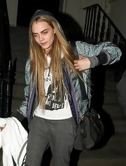 Cara Delevingne carried a two-way roomy bag while out during London Fashion Week.