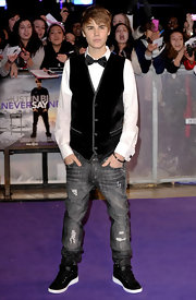 Justin wore faded black jeans with his crushed velvet vest for the 'Never Say Never' Paris premiere.