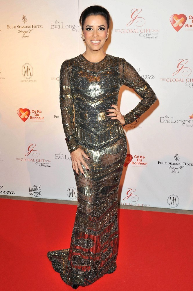 Eva Longoria wears a sheer metallic beaded gown as she attends The Global Gift Gala held at the Four Seasons Hotel.