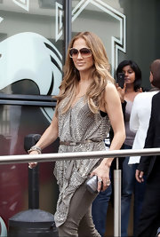 Jennifer Lopez knows there is nothing like a great belt to accentuate her curves. Here she nips her waist with a slim silver cincher.