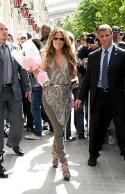 JLo headed out in Paris in high-wattage style, wearing an intricately beaded asymmetrical top.